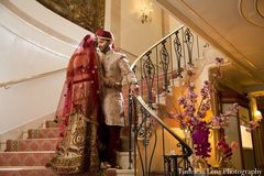 This Indian bride and groom celebrate their marriage with a traditional wedding ceremony in a gorgeous venue.