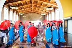 An Indian bride poses with her bridal party.