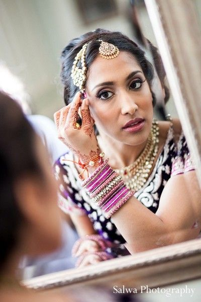 Bridal fashions, hair and makeup in Rockleigh, NJ Indian Wedding by Salwa Photography