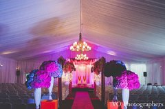 This traditional Indian wedding ceremony takes place under a gorgeous, sparkling mandap.