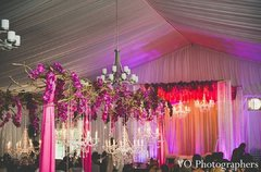 This Indian wedding reception is absolutely stunning in bright floral decor and twinkling chandeliers.