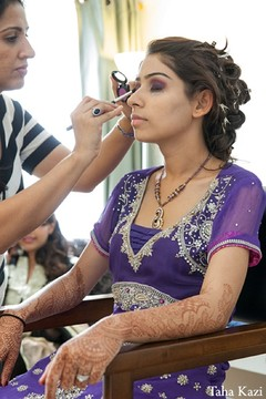An Indian bride gets dolled up for her wedding reception.