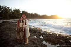This Indian bride and groom have tied the knot and now they're ready to pose for some beautiful portraits with their wedding party!