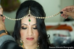 An Indian bride and groom get ready for their beach wedding.