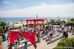 An Indian bride and groom have an vibrant beach wedding ceremony.