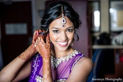 An Indian bride gets ready for reception in a purple lengha.