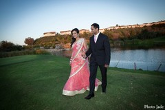 An Indian bride and groom take wedding portraits.