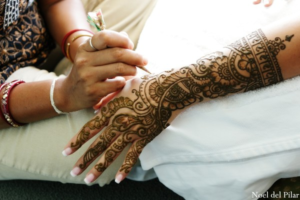 A bride gets mehndi applied for her wedding.