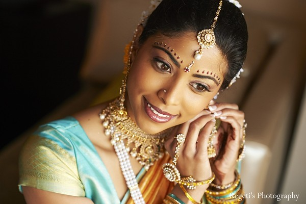 indian bride,indian bridal fashions,indian bridal portraits,hair and makeup,indian bride getting ready,indian bridal hair,bridal hair,bridal hair and makeup,portraits of indian brides,bridal fashions,indian photography,indian photographer