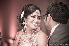 This Indian bride is all smiles at her wedding reception!