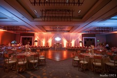 This Indian wedding reception is gorgeous with lavish floral and decor.