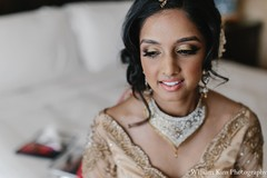 This Indian bride prepares for her big day with professional styling.