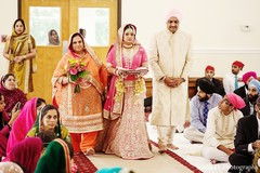 An Indian bride and groom wed in a Sikh ceremony.