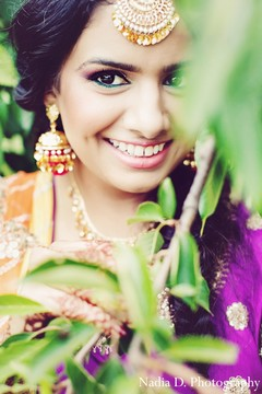 A bride poses for sangeet portraits.