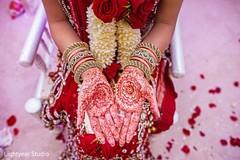 A bride shows off her wedding mehdni.
