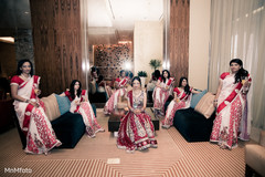 A bride has fun with her bridal party.