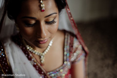 This bride prepares for her wedding day with beautiful makeup.