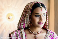 An Indian bride and groom get ready for their wedding.