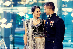 An Indian bride and groom celebrate at their wedding reception.