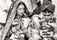 An Indian bride and groom wed in a traditional ceremony.