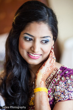 An Indian bride gets ready for some post-wedding fun with some portraits before her reception!