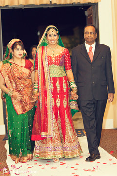 This Indian bride walks down the aisle to meet her Raja.