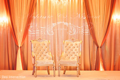 This Indian wedding reception is a glittering event with lovely floral and decor.