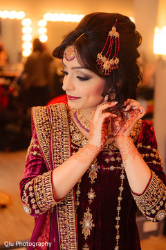 This beautiful Pakistani bride gets all dolled up for her muslim wedding ceremony.