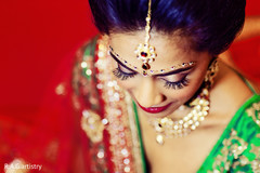 A bride shows off her hair and makeup.