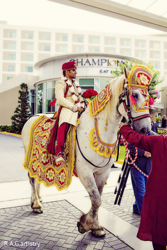 An Indian groom makes his appearance during his baraat.