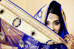 An Indian bride and groom are brilliant in royal blue for their wedding reception.