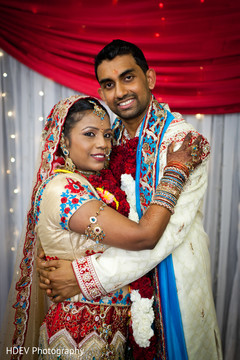 This Indian bride and groom pose for beautiful portraits after their colorful ceremony.