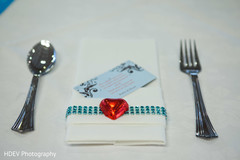 This Indian wedding reception includes lovely heart-shaped favors for guests.