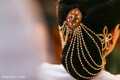 An Indian bride shows off her glam hair accessories.