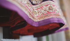 This Indian bride opts for a lovely purple lengha for her wedding ceremony.