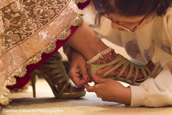 indian bride,indian bride getting ready,portraits of indian wedding,images of bride,indian bridal fashions,details for indian bridal fashions,indian wedding details,indian bridal accessories,indian wedding shoes,indian bridal footwear