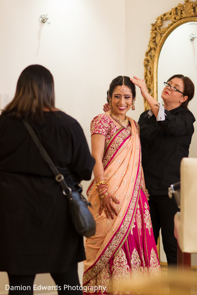 indian bride,indian bride getting ready,portraits of indian wedding,images of bride,indian bridal fashions,details for indian bridal fashions,indian wedding details,indian wedding lengha,indian wedding lehenga