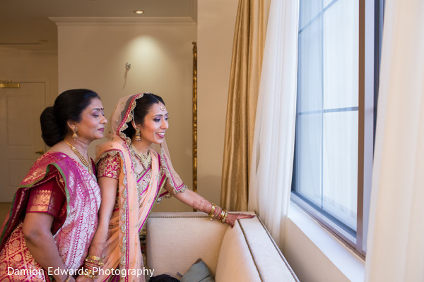 portrait of indian bride,indian bridal portraits,indian bridal portrait,indian bridal fashions,indian bride,indian bride photography,bride watching baraat,portrait of bride watching baraat,bride watches baraat,indian bride watches baraat
