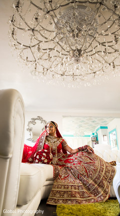 An Indian bride and her groom pose for wedding portraits!