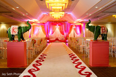 This beautiful Indian wedding ceremony includes lovely floral and decor.