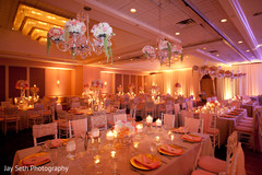 This Indian wedding reception features beautiful floral and decor.