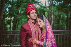 This Indian bride and groom pose for beautiful wedding portraits.