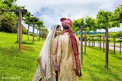 An Indian bride and groom take some precious portraits after their wedding ceremony!