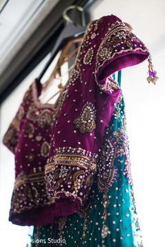 An Indian bride and groom celebrate at their wedding reception!