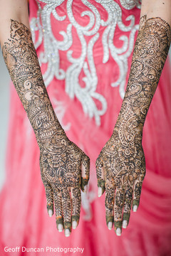 This Indian bride gets beautiful henna designs done for her wedding day.