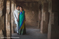 This Indian bride and groom pose for beautiful outdoor portraits before their wedding ceremony.