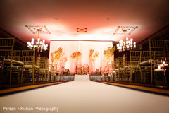 This Indian wedding ceremony features beautiful floral and decor.