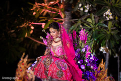 An Indian bride and groom wed in an extravagant night time ceremony in Bangkok, Thailand.