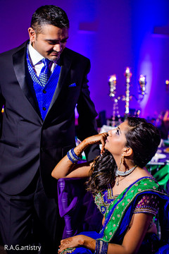 An Indian bride and groom celebrate at their reception in Cancun, Mexico!