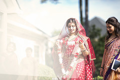 This Indian bride opts for a red sari for her wedding day.